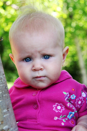 generration: Little Baby Girl posing in trees