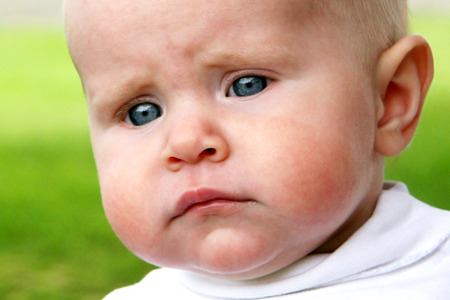 Baby taken closeup with sad face