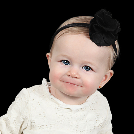 Cute baby girl with accessory