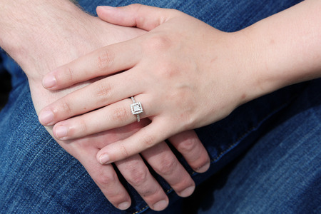 Hands together showing the ring