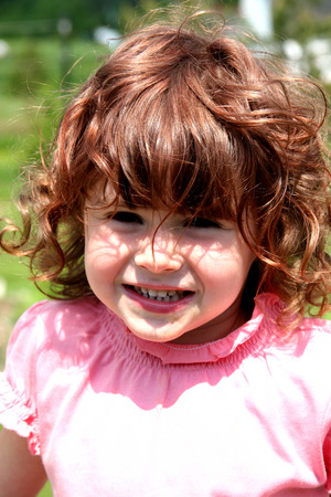 generration: Little girl with big smile and red hair