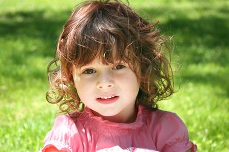 generration: Little Girl Outdoors in the Grass Stock Photo