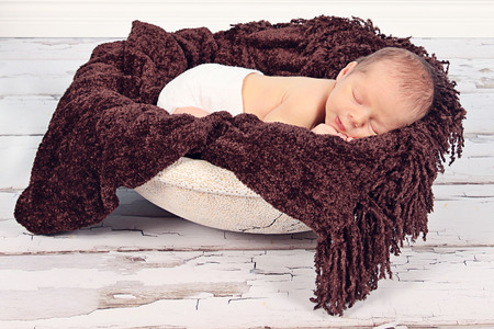 Cute newborn baby boy posing for camera Stock Photo
