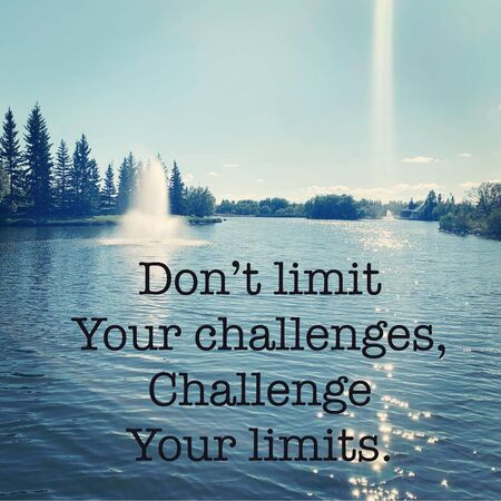 Inspirational Quote - Dont limit your challenges, Challenge your limits. with lake in background