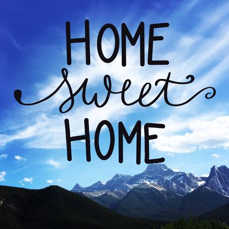 Inspirational Quote - Home Sweet Home with Mountains in background Stock Photo