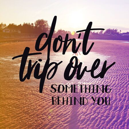 Inspirational Quote with lake background - Dont trip over something behind you