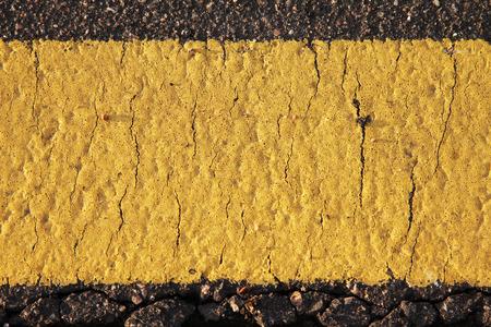 road mark: Yellow road mark texture close up