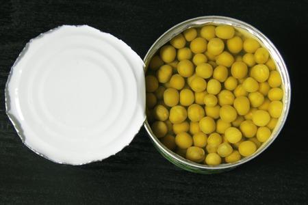 canned peas: Canned peas on black