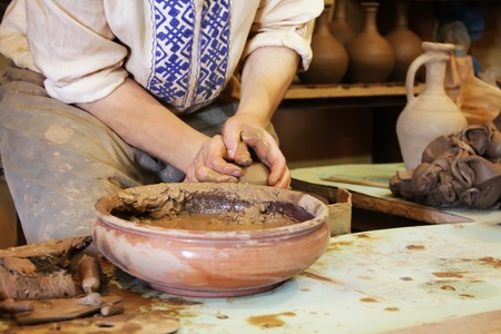 clue: Ceramic pottery making proccess. Handmade clue pottery. Potter hands. Stock Photo