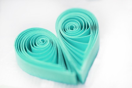 Quilling handmade heart. Made of paper heart in quilling style