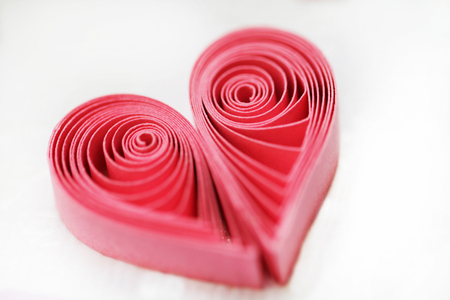 Quilling handmade heart. Made of paper heart in quilling style with selective focus