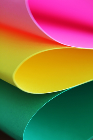 stack of paper: Abstract paper stack defocused colourful background. Paper stack of different colors defocused