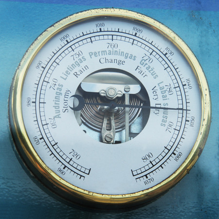 weather gauge: Retro barometer close up photo in vintage style Stock Photo