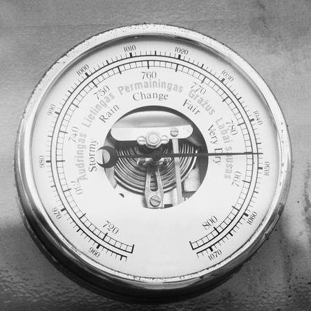 pluviometro: Retro barometer close up photo in vintage style Foto de archivo