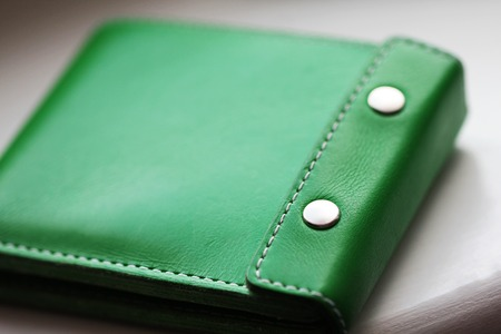 Green stylish leather wallet close up photo Stock Photo
