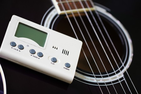 tuner: Guitar and tuner for toning musical instruments