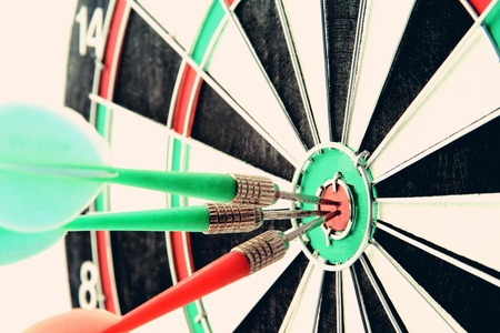 entertainment center: Darts board close up in vintage style. Concept of accuracy and success Stock Photo
