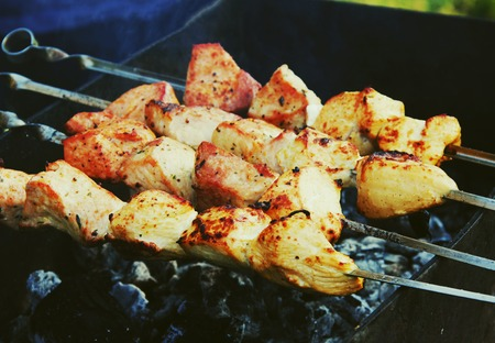 Shashlik meat barbecue cooking on hot coals Stock Photo