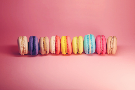 Bright food photography of macroons on pink background