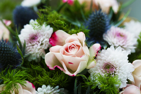 Bouquet of flowers with roses and other plants close up