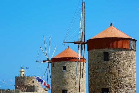 Greece Rhodes old miills on blue sky near the sea