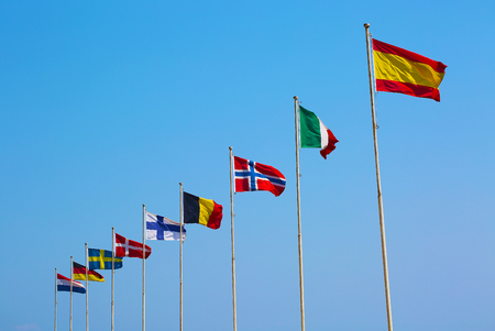 Flags of European countries waving on blue sky