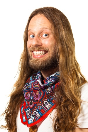 60s hippie: Close up portrait of a very happy hippie man  Isolated on white  Stock Photo