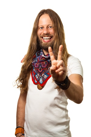 man with long hair: Portrait of a smiling and handsome man giving a peace sign isolated on white