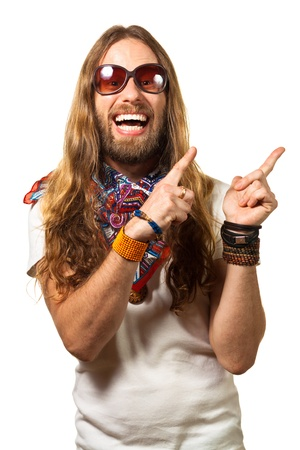 Happy and silly man dressed like a hippie pointing up at copyspace  Isolated on white  Standard-Bild