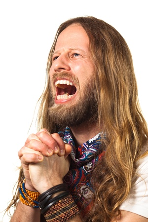 Man dressed as a hippie screaming in a desperate, emotional prayer  Isolated on white  Standard-Bild