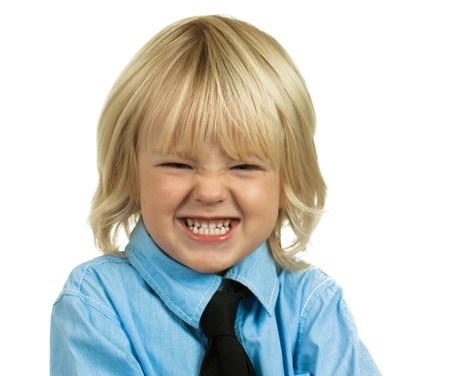 Portrait of a well-dressed angry young boy. Isolated on white. Standard-Bild