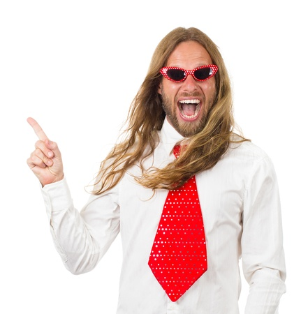 Funny and silly portrait of a hippie man in a bright tie and sunglasses pointing at copy space. Isolated on white. photo