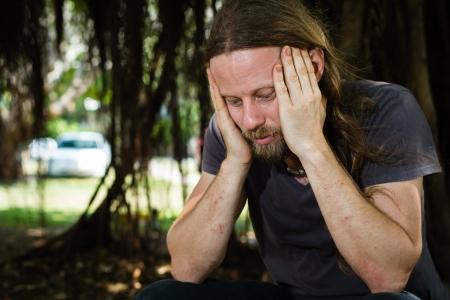 depressed man: Portrait of a depressed man thinking outdoorsg Stock Photo