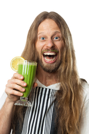 Fun portrait of a very happy hippie man drinking a green vegetable smoothie  Isolated on white