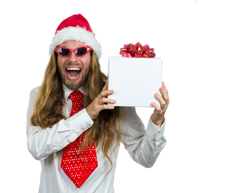 Surprised hippie in Santa hat and retro glasses holding a white present. Isolated on white background. photo