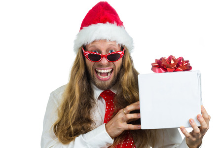 Excited retro hippie Santa holding a white present  isolated on a white background photo