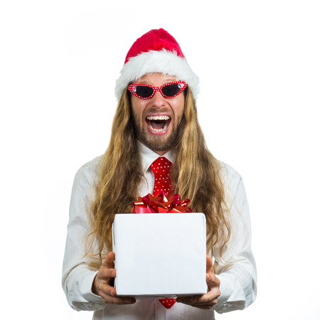 Excited retro hippie in Santa hat holding a white wrapped gift  Isolated on white background