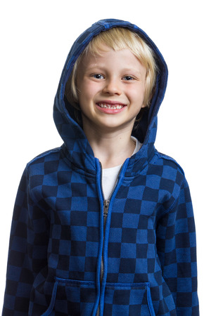 Happy, healthy child wearing a hoodie isolated on white photo