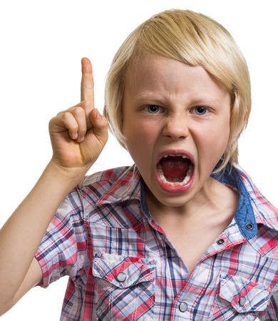 angry child: Close-up portrait of shouting angry boy with finger raised isolated on white