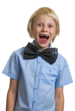 Very surprised boy in big black bow tie isolated on white background photo