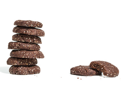 Stack of healthy dark chocolate cookies with raw cacao and chia seeds
