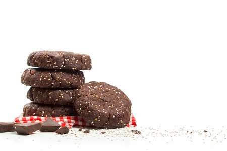 chia seed: Stack of healthy dark chocolate chia seed cookies with ingredients Stock Photo