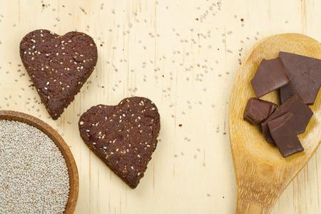 Healthy dark chocolate chia seed love heart cookies and ingredients