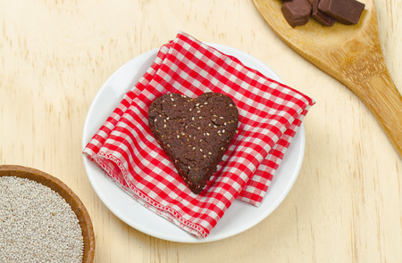 Delicious healthy homemade chocolate chia seed loveheart cookie snack
