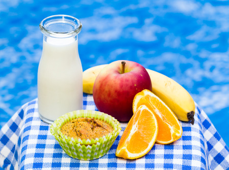 Healthy kids snack with wholemeal homemade muffin, fresh fruit and milk