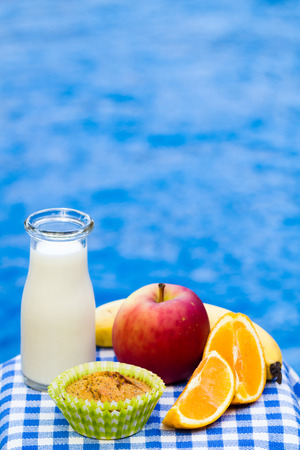 Healthy snack with homemade muffin, fruit and fresh milk