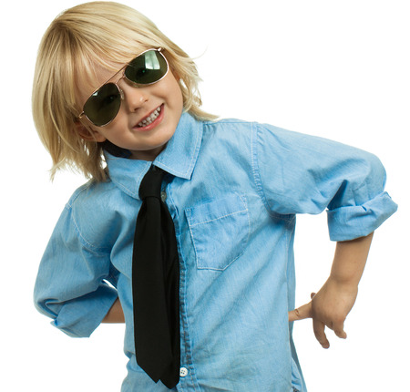 Portrait of a well-dressed cute boy wearing sunglasses and a shirt and tie. Isolated on white.