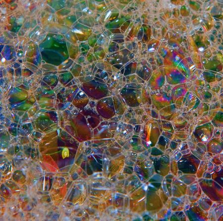 sudsy: colorful glass beads seen and reflected through sudsy, soapy water