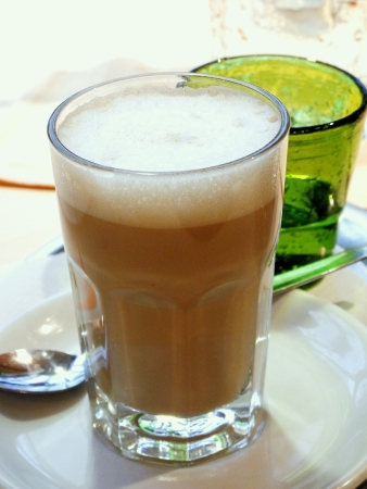 Glass with latte macchiato in a caf� Stock Photo - 17724134