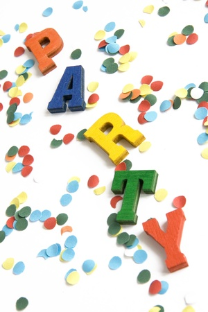 Wooden letters spelling party, on white background with confetti Stock Photo - 21627707